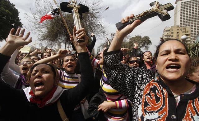 """Egyptian Coptic Christians demonstrate outside the state radio and television building in central Cairo."" Photo by Al Arabiya News. Available via http://english.alarabiya.net/articles/2011/12/29/185105.html"