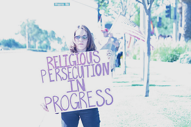 """Sign: Religious Persecution in Progress, November 2008"" by John Nakamura Remy. Available via: https://www.flickr.com/photos/mindonfire/3036482000"