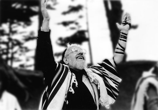 """Reb Zalman in celebratory prayer at Baker's Beach, California."""