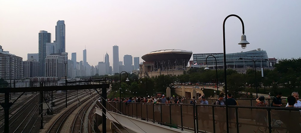 Fans without tickets strain to hear the Grateful Dead's final performance outside Soldier Field in Chicago on July 5, 2015. Photo by author.