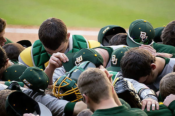 "Baylor University Baseball players pray before the Astros Foundation College Classic in Houston, TX, March 1, 2013. Photo by Flickr user ""thatlostdog--."" Available via Flickr."