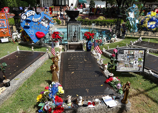 Elvis' grave at Graceland. Photo by Nick Shields, August 26, 2012. Available via Flickr.